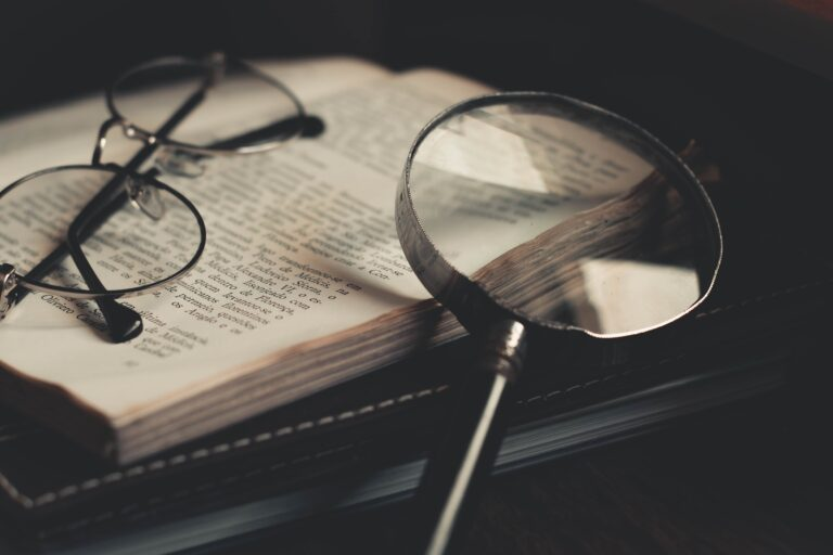 Glasses and magnifying glass